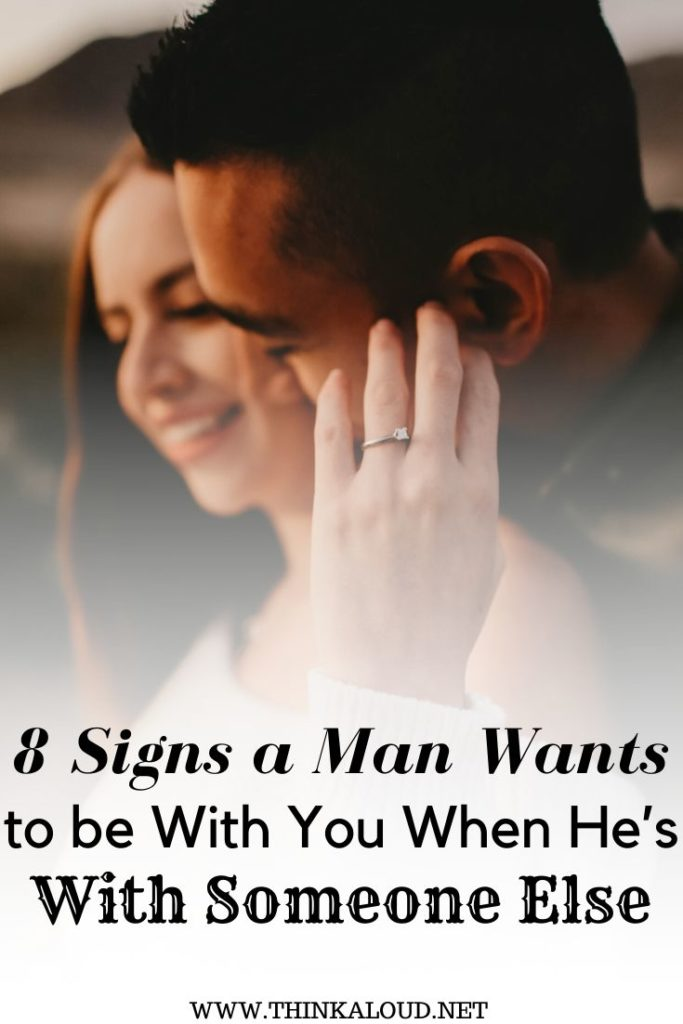 8 Signs a Man Wants to be With You When He's With Someone Else